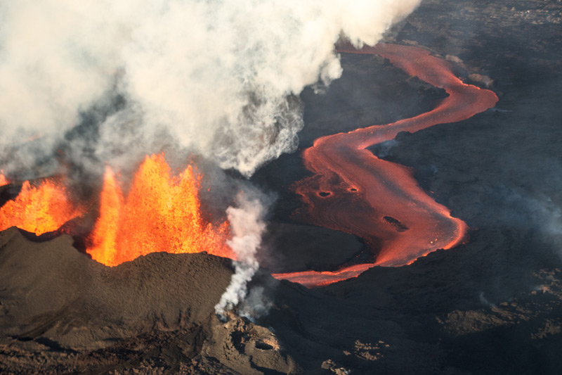 Volcanic eruption: fire-breathing volcano and flowing lava